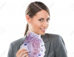 Business Woman holding and showing a lot of five hundred euro banknotes on a white isolated background