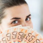 woman-hiding-her-face-behind-euro-money-fan-business-finance-saving-banking-people-concept-close-up-57272349