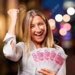 senior beautiful woman with euro bills